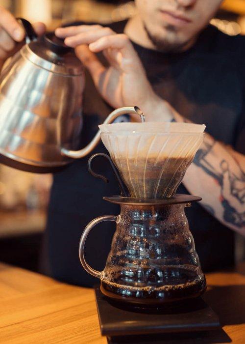 a barista serving Brasilmoka coffee